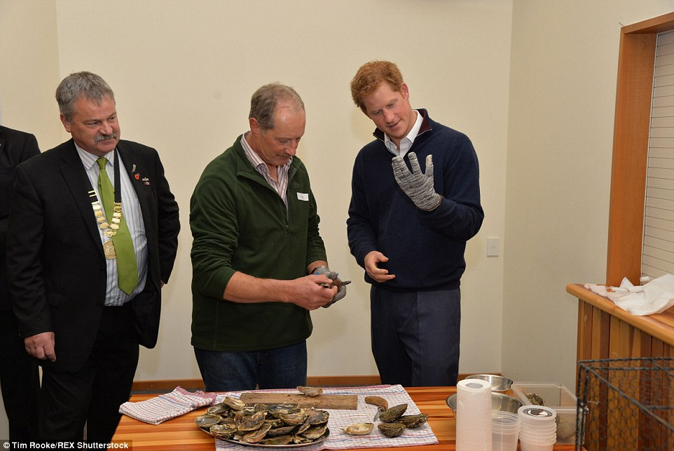 Jim shows Harry how to shuck oysters